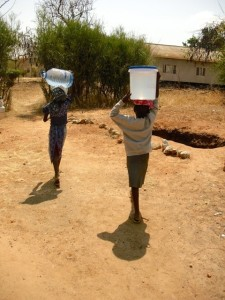 Girls walking off with water